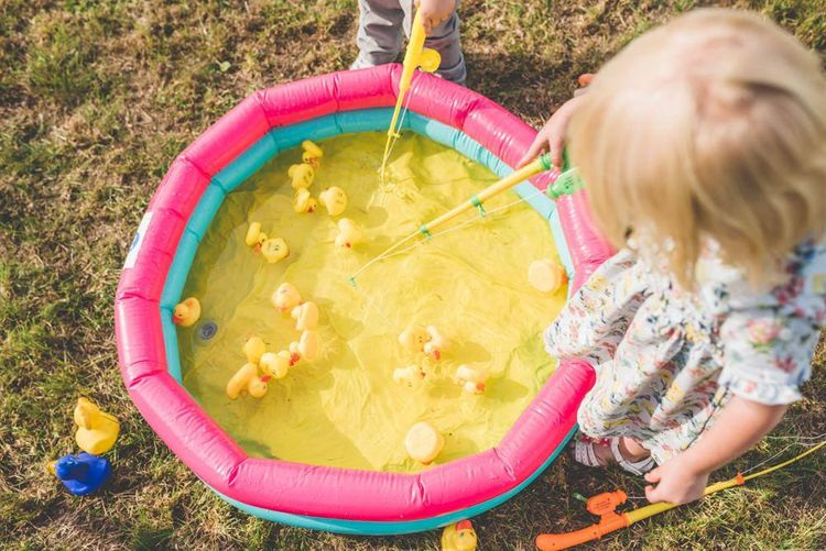 Hook a Duck at this village fete themed fun outdoor reception