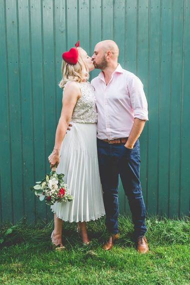 Bride wearing two piece gown with a midi wedding skirt and embellished top
