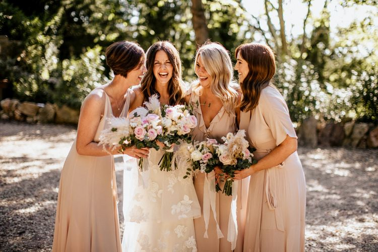 Bridal Party Portrait with Bridesmaids in Pink Reformation Dresses and Bride in Emma Beaumont Wedding Dress