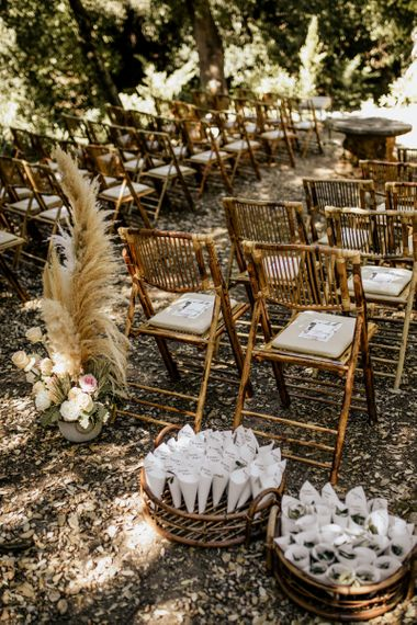 Outdoor Wedding Ceremony Decor with Bamboo Chairs, Pampas Grass Floral Arrangements and Personalised Confetti Cones
