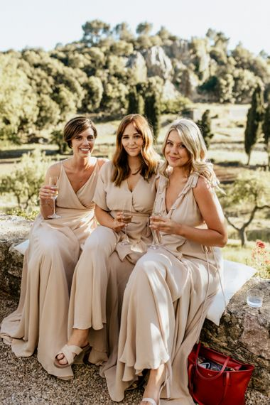 Bridesmaids in Reformation Dresses