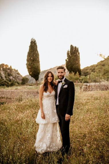 Bride in Emma Beaumont Wedding Dress and Groom in Givenchy Tuxedo