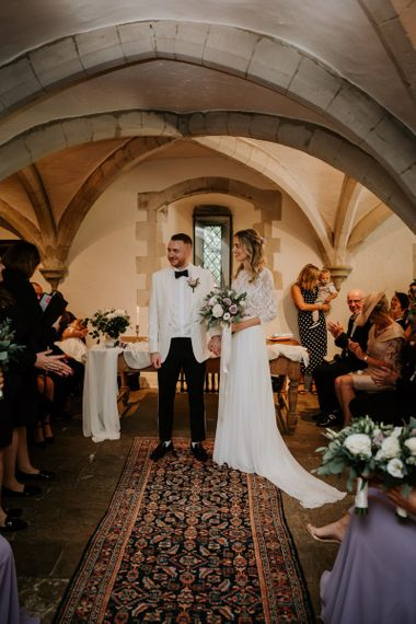 Bride and Groom Standing at the Altar in Nettlestead Place in Kent