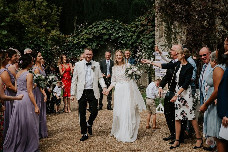 Confetti Moment with Bride in Separates and Groom in White Dinner Jacket