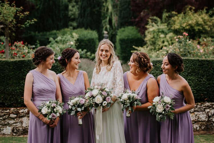 Bridal Party with Bridesmaid in Purple Dresses and Hair Braids