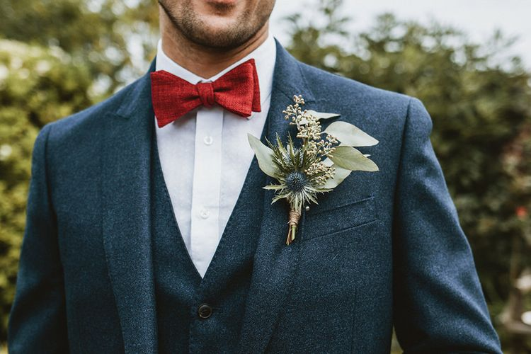 Groom in Blue Three-Piece Suit with Red Bow Tie