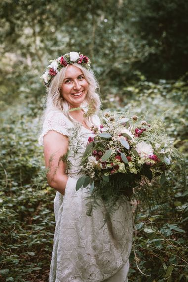 Bride with Oversized Bouquet of Wild Trailing Flowers
