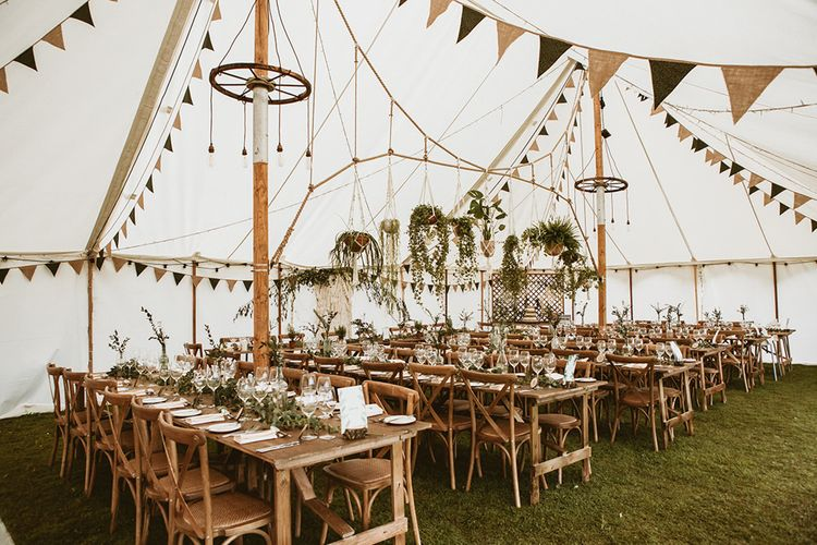 Tipi Interior with Bunting and Hanging Pot Plants