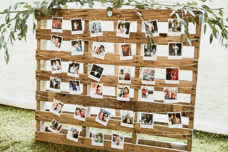 Polaroid Photos on Wooden Pallet