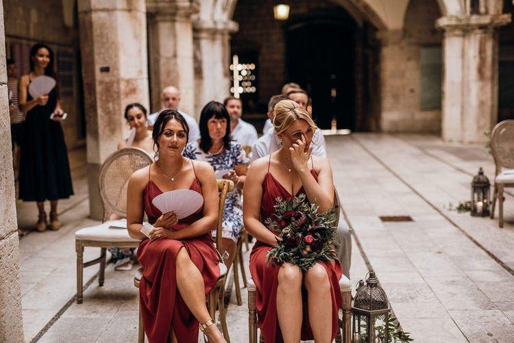 Bridesmaids watch on as same-sex couple get married