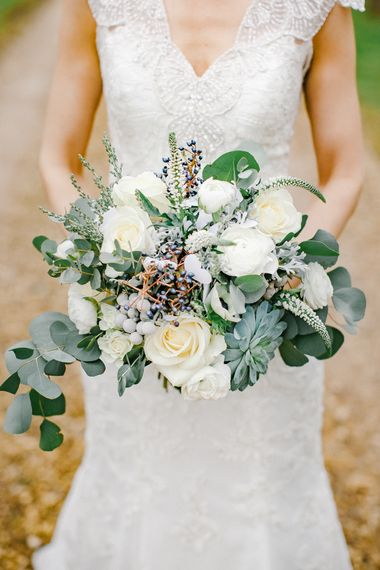 Winter Wedding Bouquet With White Flowers And Foliage // Elegant Christmas Wedding With Navy And Gold Colour Scheme At Dodmoor House With Bride In Maggie Sottero And Images From Chris Barber Photography