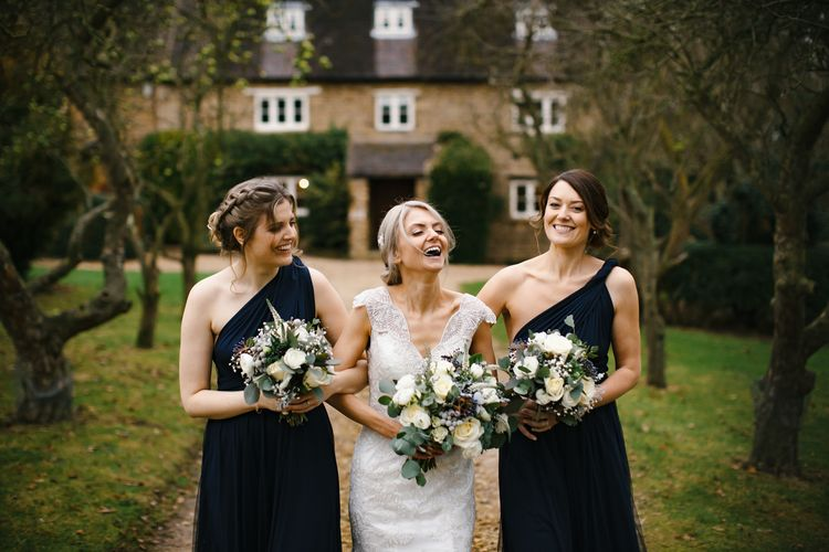 Bridesmaids In Navy Maxi Dresses // Elegant Christmas Wedding With Navy And Gold Colour Scheme At Dodmoor House With Bride In Maggie Sottero And Images From Chris Barber Photography