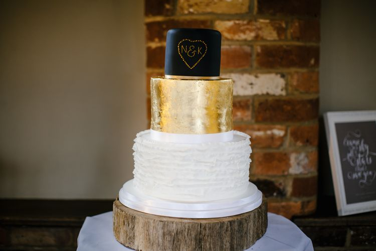 White, Gold And Navy Wedding Cake // Elegant Christmas Wedding With Navy And Gold Colour Scheme At Dodmoor House With Bride In Maggie Sottero And Images From Chris Barber Photography