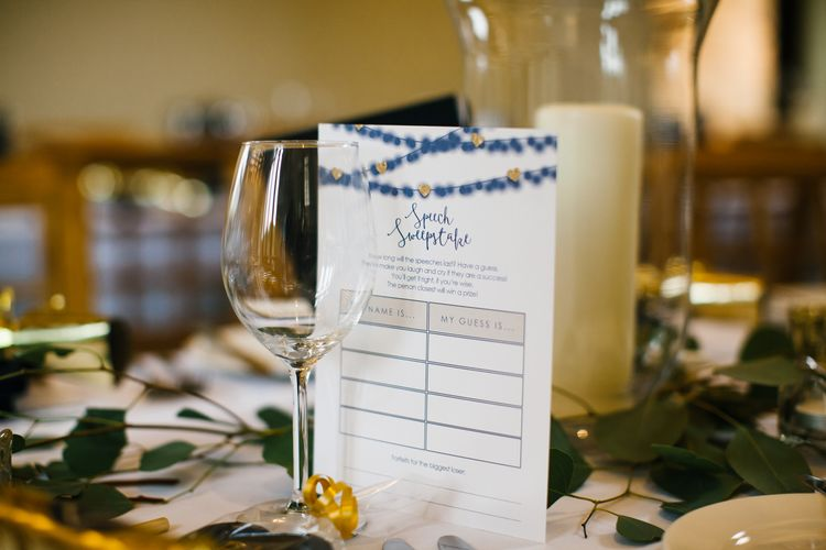 Speech Sweepstake Table Games For Wedding // Elegant Christmas Wedding With Navy And Gold Colour Scheme At Dodmoor House With Bride In Maggie Sottero And Images From Chris Barber Photography