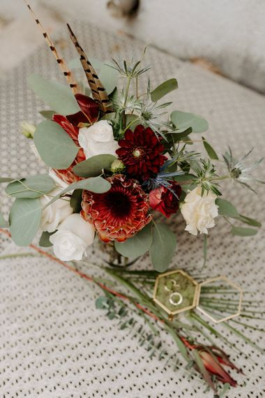 King protea wedding bouquet with red and white flowers