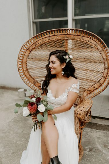 Bride wearing beautiful bridal separates with king protea wedding bouquet