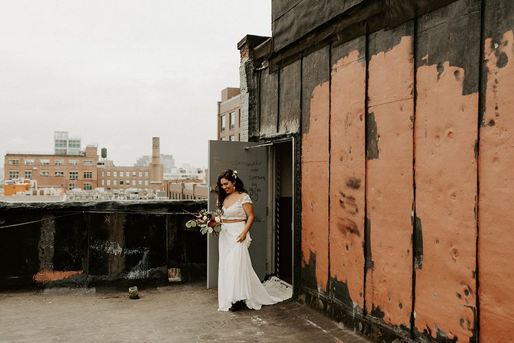 Bride walking to a first look with her groom wearing bridal separates for Brooklyn elopement