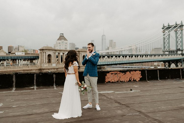Bride and Groom first look moment on rooftop building with Manhattan skyline for Brooklyn elopement