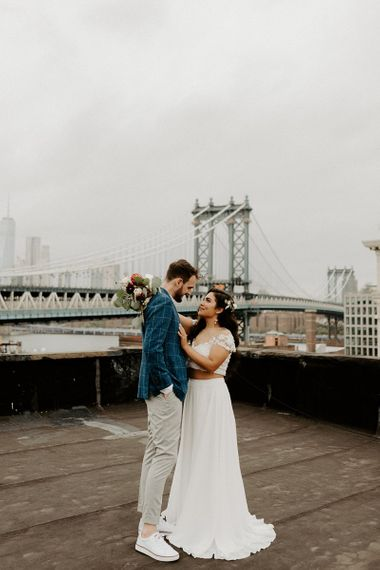Bride and Groom first look moment on rooftop building with Manhattan skyline and bridal separates