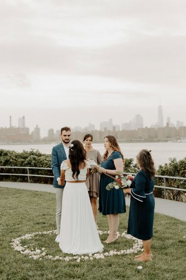 Bride and groom tie the knot at a park overlooking the East River and the NYC skyline