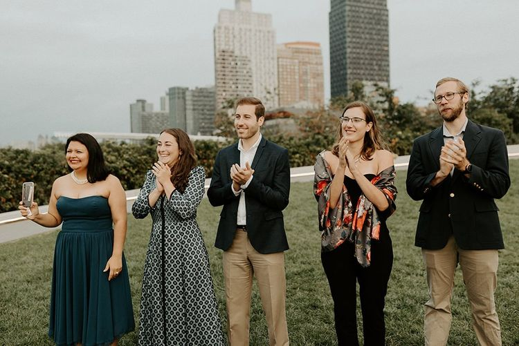 Guests enjoying Brooklyn elopement with NYC skyline backdrop