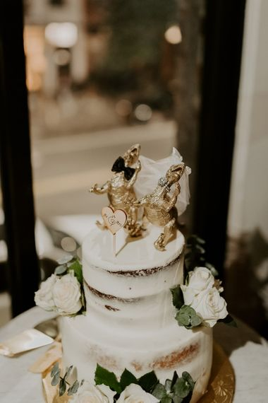 Semi naked wedding cake with personalised dinosaur cake topper
