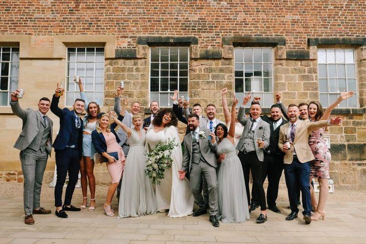 Wedding party in front of industrial wedding venue in Derbyshire