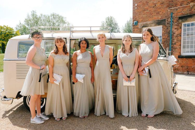 Pastel bridesmaid dress with wedding car