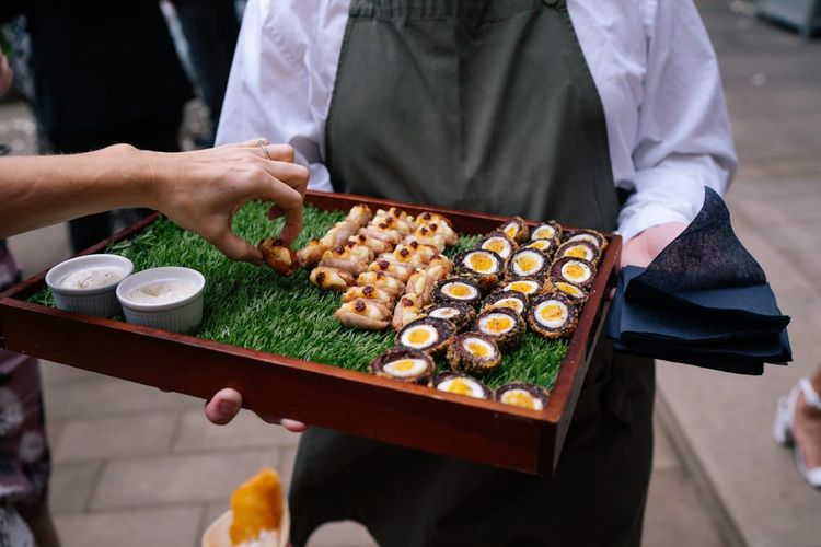 Canapes at industrial wedding with customised neon light