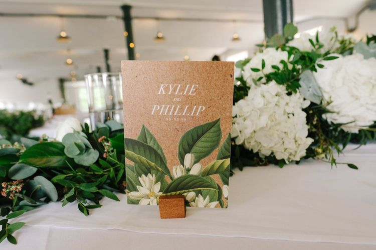 Wedding table decor with place names and white flowers