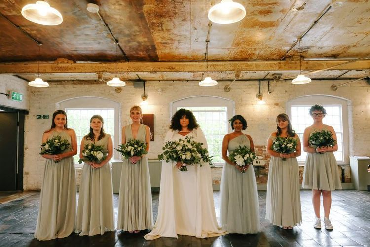 pastel green bridesmaid dresses with white wedding bouquets