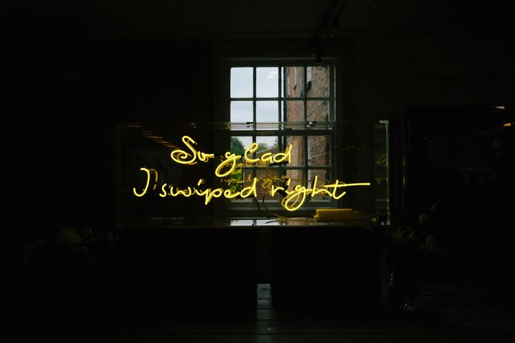 Customised neon sign for couple who met on Tinder