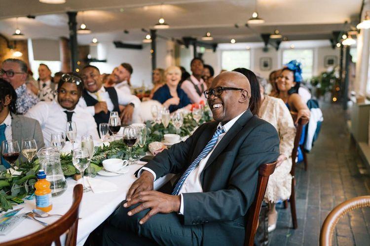Guests enjoy the wedding speeches