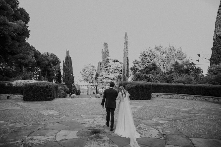 Bride and Groom Walking Through Their Venue