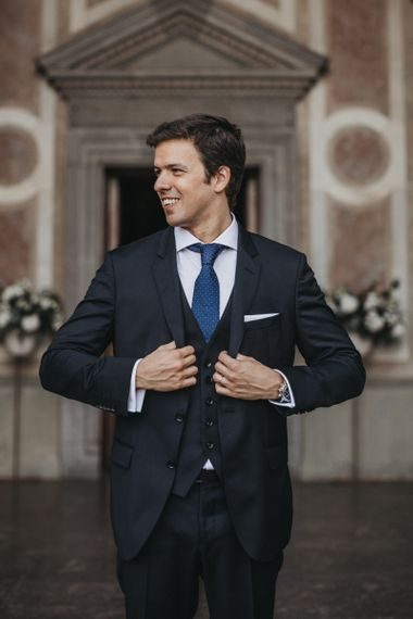 Groom in Three Piece Wedding Suit with Blue Tie
