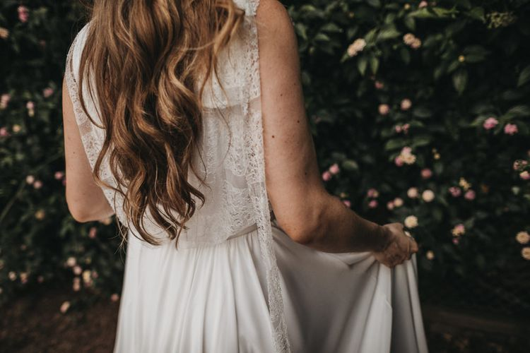 Bride in Lace Back Wedding Dress with Long Wavy Hair