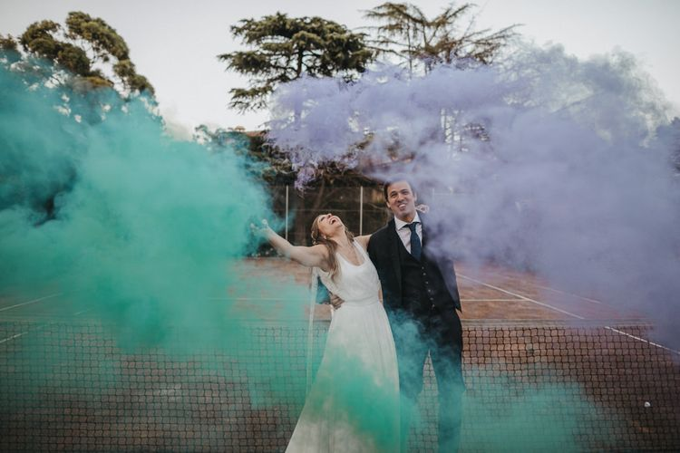 Bride and Groom with Turquoise and Lilac Smoke Bombs