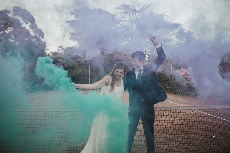 Bride and Groom Coloured Flares Wedding Portrait