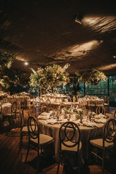 Wedding Reception Decor with Floral Installations, Gold Accents and Candle Light