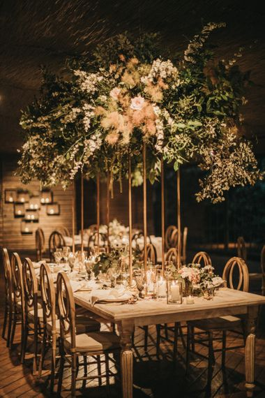 Tall Floral Centrepieces on Copper Stands with Pampas Grass and Foliage