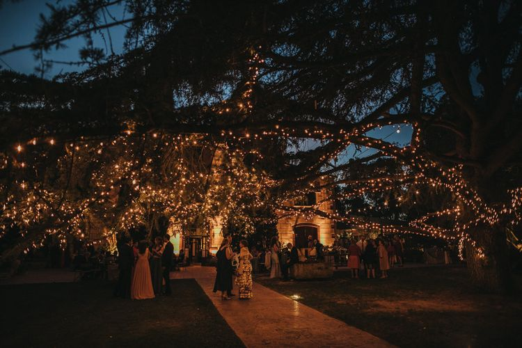 Outdoor Wedding Reception Lighting with Tree Covered in Fairy Lights