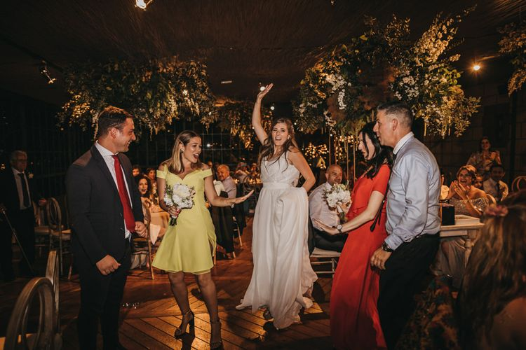 Bride and Guests Dancing on the Dance Floor