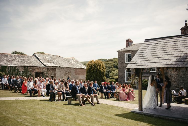 Outdoor Wedding Ceremony At Launcells Barton // // Image By McGivern Photography