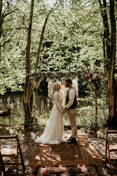 Boho Bride and Groom Standing at the Outdoor Woodland Altar