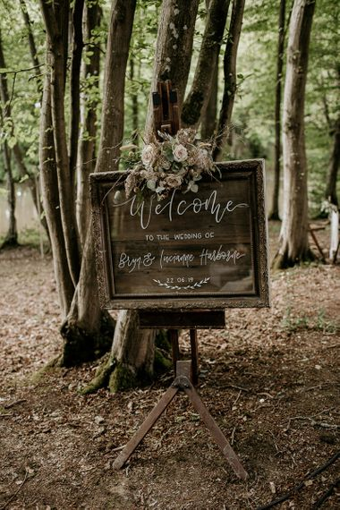 Wooden Wedding Welcome Sign on an Easel Decorated with Dried Flowers