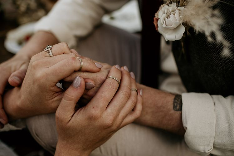Boho Bride and Groom Holding Hands with Wedding Rings