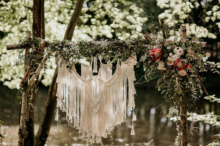 Wooden Altar Covered in Foliage with Hanging Macrame Decor