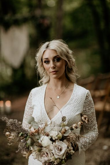 Beautiful Boho Bride with Long Sleeve Lace Wedding Dres and Muted Wedding Bouquet
