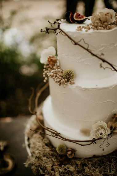 Buttercream Wedding Cake Decorated with Twine and Woodland Flowers