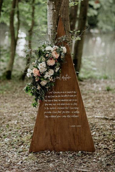 Wooden Triangle Wedding Sign with Quote and Floral Decor